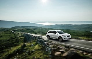 Image of white 2017 MDX driving outdoors